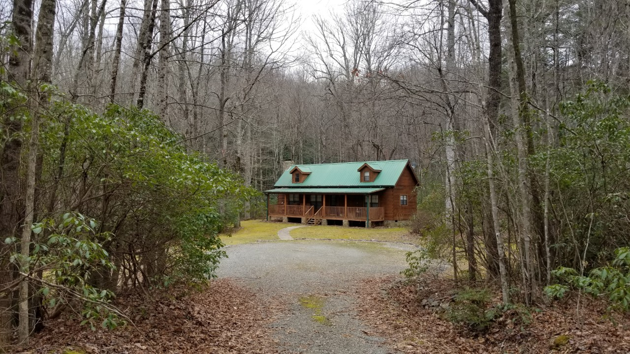 Gorgeous log cabin vacation rental on 17 wooded acres with a trout pond in Cedar Mountain, near Brevard, Hendersonville, and Dupont State Forest NC